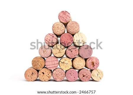 Pyramid of assorted wine corks over white background - stock photo