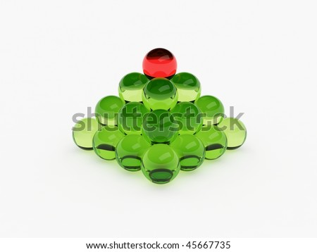 Pyramid of balls, with one different on top - stock photo