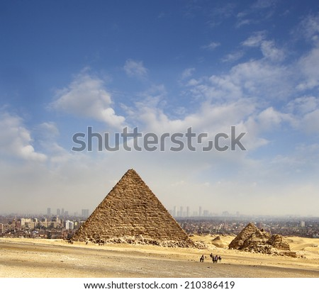 Pyramid of Giza, in the background the city of Cairo, Egypt, UNESCO World Heritage Site - stock photo
