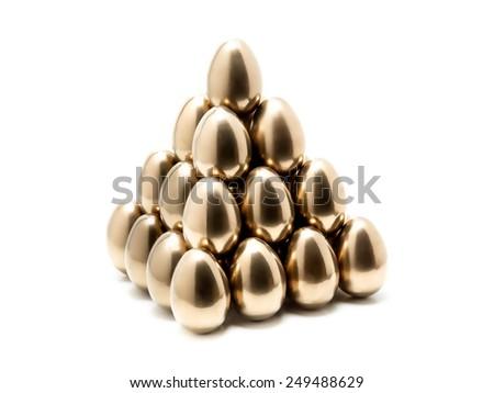 Pyramid of golden eggs on white background - stock photo