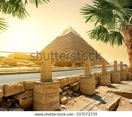 Pyramid of Khafre and asphalted road with columns - stock photo