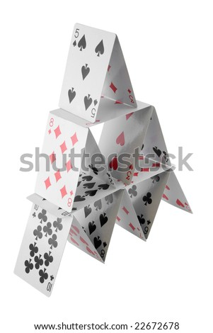 Pyramid of playing cards isolated on white - stock photo
