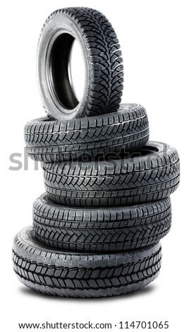 Pyramid of tires isolated on the background - stock photo