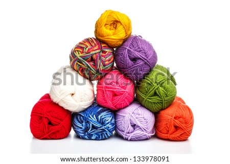 Pyramid of yarn for knitting on a white background - stock photo