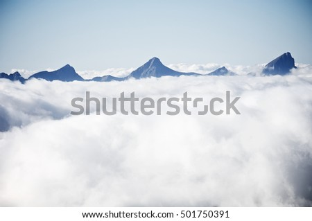 pyramid shaped peaks and sea of clouds in the Pyrenees