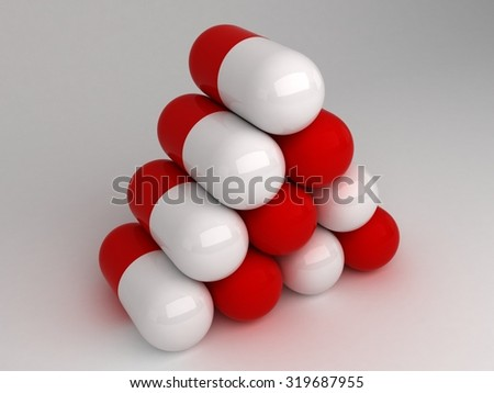 Pyramid stack of ten red white pills - stock photo