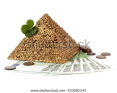 Pyramid with clover standing on euro money on white background.100 hundred euro.Euro notes and coins.Financial background. Get Good Luck With Money.Lucky money numbers.Lucky Money.Lucky money symbols  - stock photo