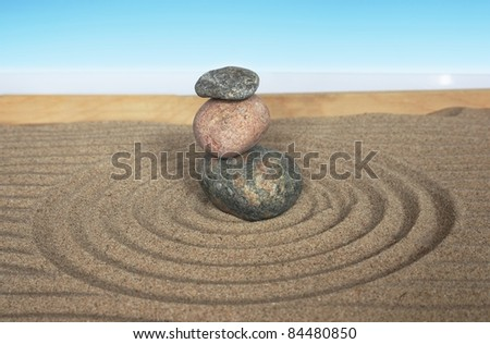 pyramid with three stones on a white background