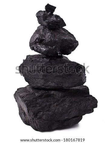 Pyramid Zen stones  black coal on white background  - stock photo
