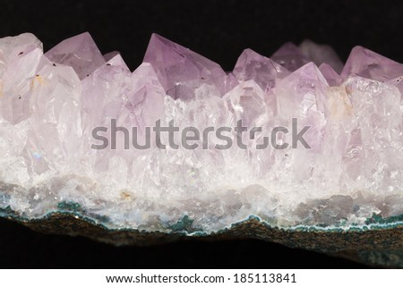 pyramidal translucent bright purple amethyst crystals with inclusions  - stock photo
