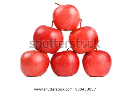 Pyramide of apples isolated on white - stock photo