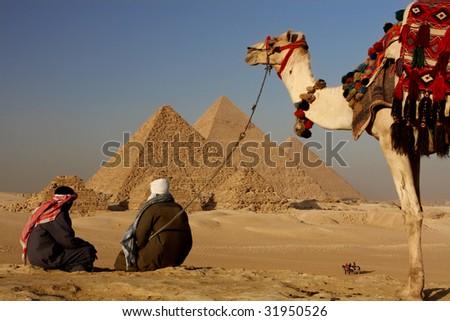 pyramids bedouins - stock photo