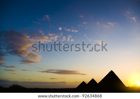 Pyramids in Giza valley under sunset light - stock photo