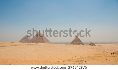 Pyramids of Giza, Cairo, Egypt with camels in the foreground