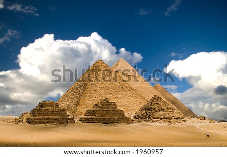 Pyramids of Gizeh near Cairo in Egypt on a cloudy day. - stock photo
