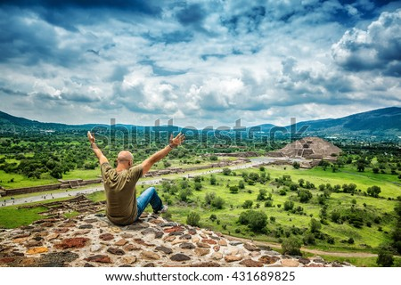 Pyramids of the Sun and the Moon on the Avenue of the Dead, Teotihuacan ancient city, old ruins of Aztec civilization, happy man enjoying traveling, Mexico, North America - stock photo