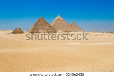 pyramids with a beautiful sky of Giza in Cairo, Egypt. - stock photo