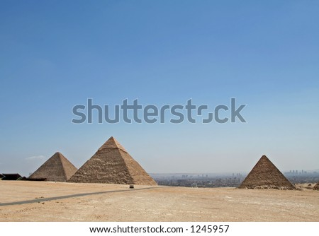 Pyramids with hazy city view at the background