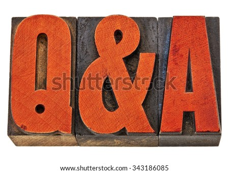 Q&A - questions and answers acronym - isolated text in vintage letterpress wood type stained by red ink - stock photo