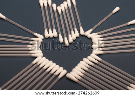 Q-tips forming a heart shape - stock photo