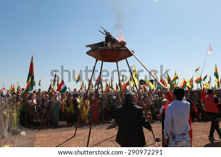 QAMISLO - MARCH 21: More than 20,000 Kurds celebrated Kurdish Festival Newroz on 21 March 2013 in Qamislo, Syria. - stock photo