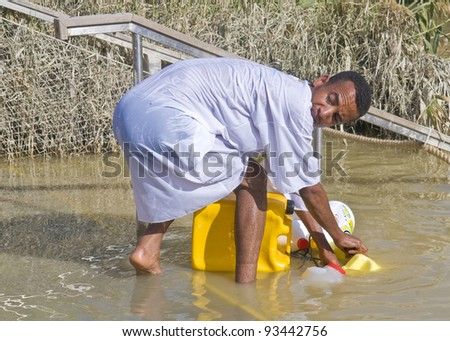 QASER EL YAHUD, ISRAEL - JAN 19 : Unidentified Ethiopian orthodox Christian man  participates in the baptizing ritual during the epiphany at Qaser el yahud, Israel in January 19, 2012
