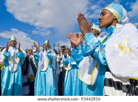 QASER EL YAHUD, ISRAEL - JAN 19 : Unidentified Ethiopian orthodox Christians participate in the baptizing ritual during the epiphany at Qaser el yahud, Israel in January 19, 2012 - stock photo