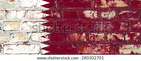 Qatar flag painted on old brick wall texture background - stock photo