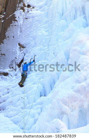 QINGLONG - JANUARY 18: Ice climbing enthusiasts use rope, climbing a frozen waterfall, on January 18, 2014, QingLong, hebei province, China.