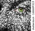 QR Code superimposed on a mans face to suggest the concept of slavery or human trafficking - stock photo