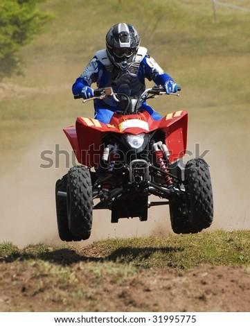 quad jumping - stock photo