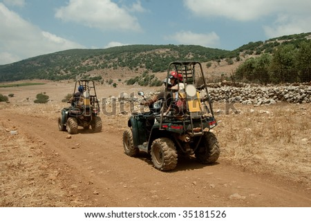 Quad motorcycle racing - stock photo