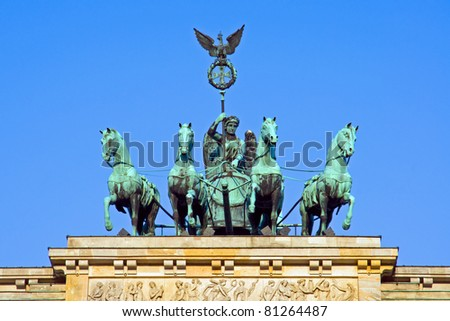 Quadriga on the Brandenburger Tor in Berlin in the early morning sun - stock photo
