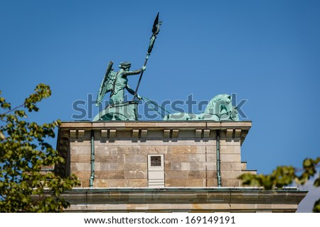 Quadriga on Top of the Brandenburger Tor (Brandenburg Gate) in Berlin, Germany - stock photo