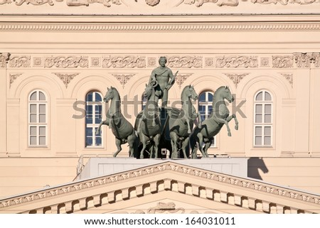Quadriga with Apollo on the roof of the Large theatre. Ancient sculpture - stock photo