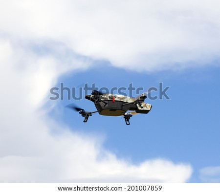 Quadrocopter with camera in the sky - stock photo