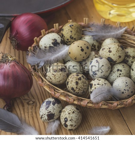 Quail eggs in a wicker basket in the kitchen in the village