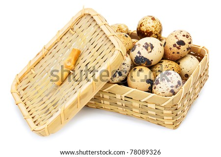 Quail eggs in basket isolated on white