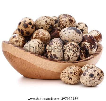 quail eggs in wooden bowl isolated on white background cutout - stock photo