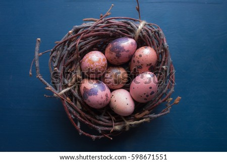 Quail eggs on the straw basket