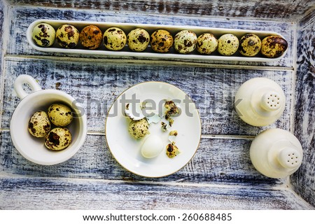 Quail eggs on wooden background - stock photo