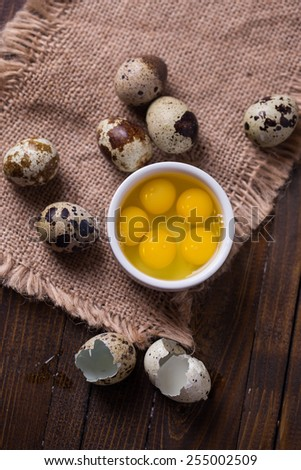 Quail  eggs on wooden background. Selective focus. - stock photo