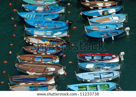 Quaint colorful fishing boats in Cinque Terre village - stock photo