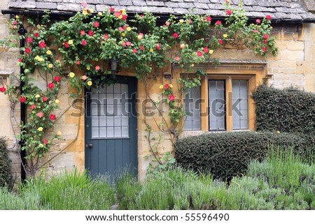 Quaint English cottage - stock photo