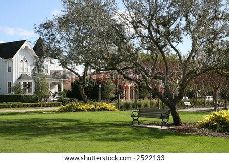 quaint homes overlook a village green - stock photo