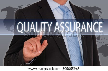 Quality Assurance - Businessman with touchscreen - stock photo