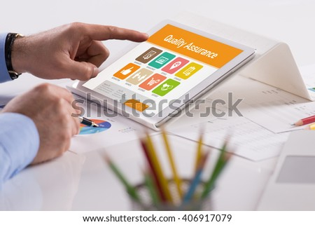 Quality Assurance screen on the tablet pc - stock photo