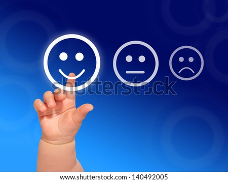Quality control concept. Baby hand pushing a button. - stock photo