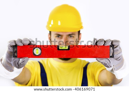 quality control - construction worker with spirit level - stock photo