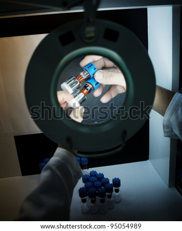 quality control of liquid medicament - stock photo